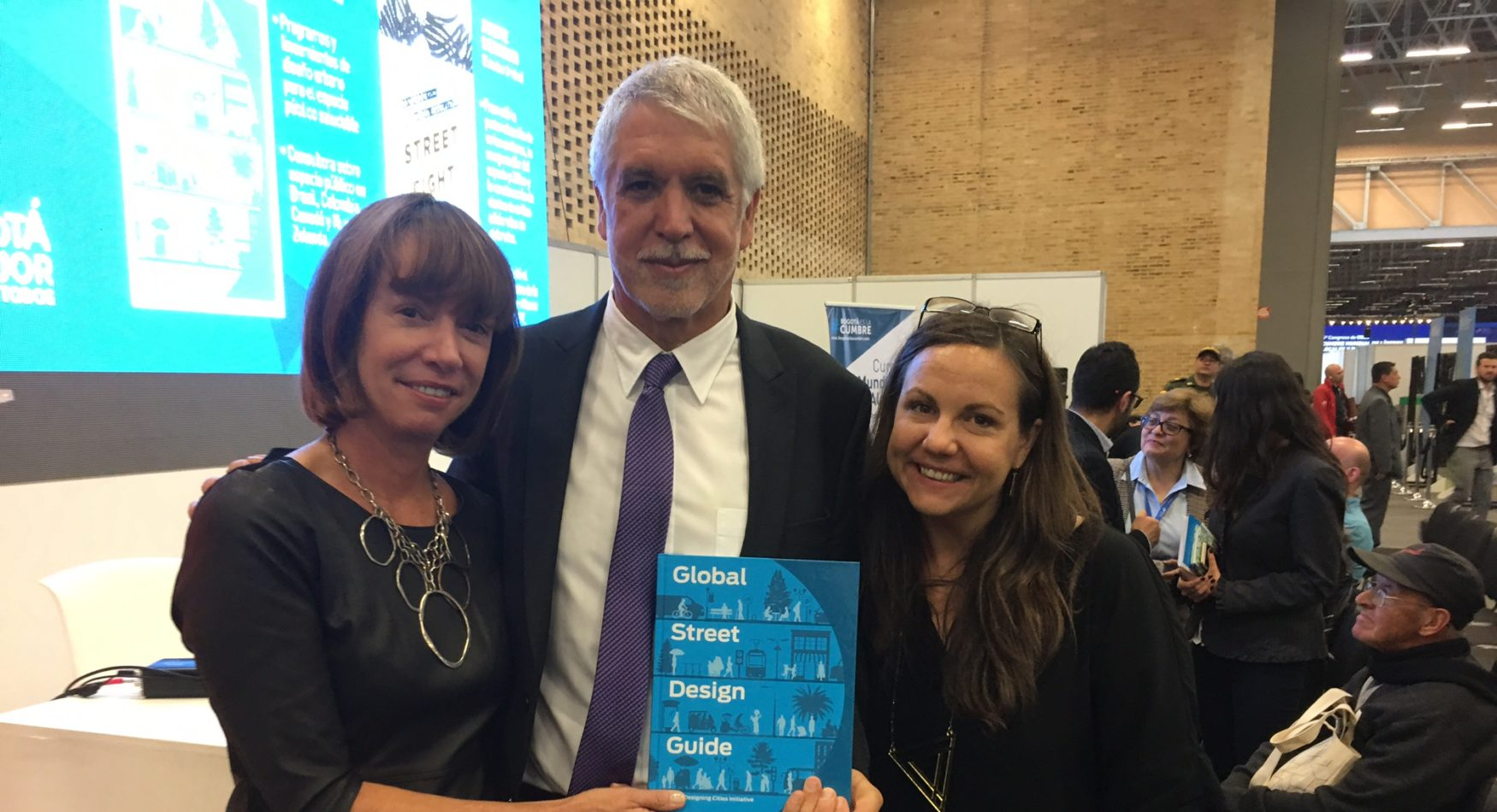 Picture of Janette Sadik-Khan, The Mayor of Bogota, and Skye Duncan holding the Global Streets Design Guide