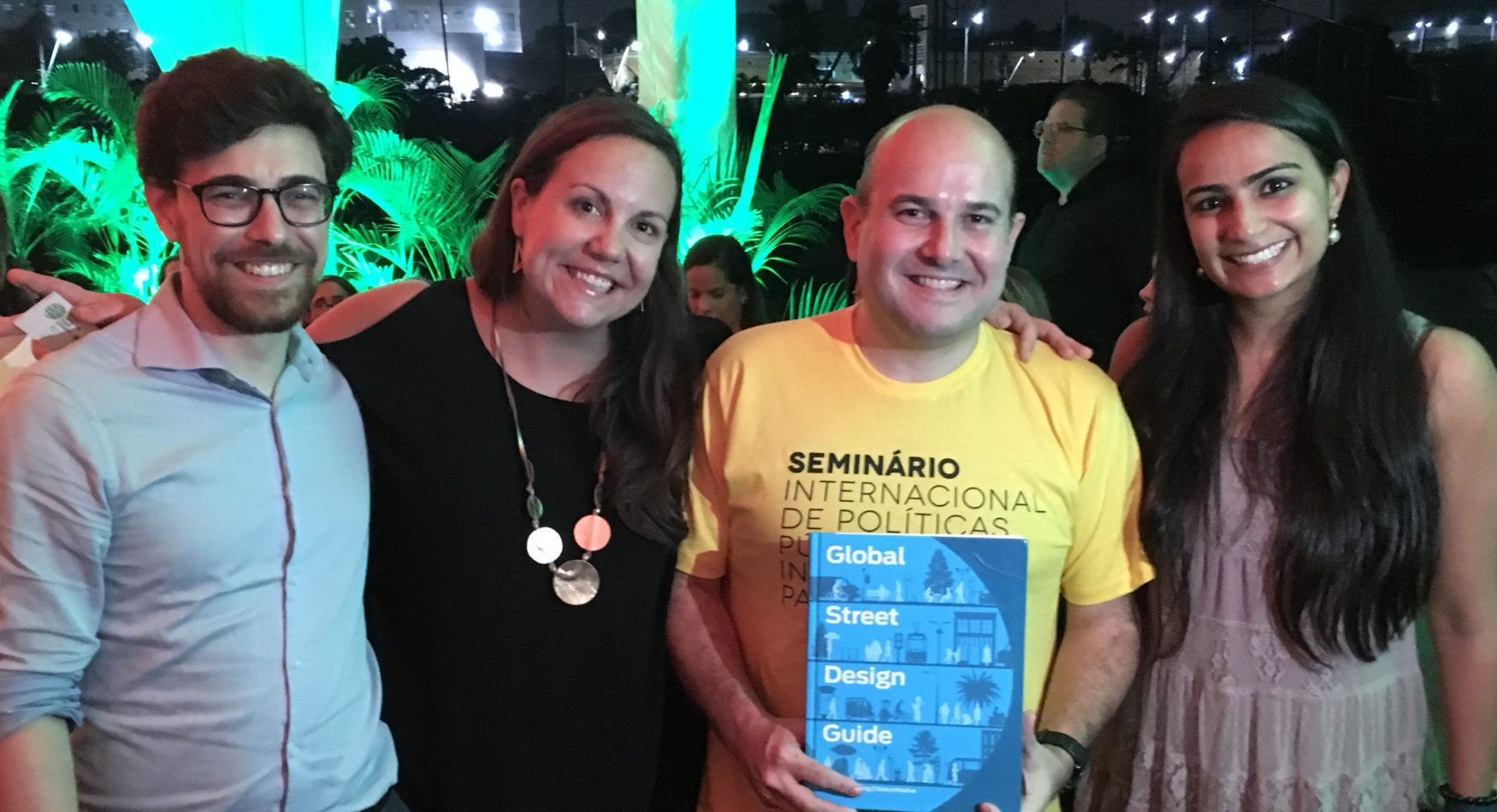 Picture of GDCI staff and the Mayor of Fortaleza holding the Global Streets Design Guide