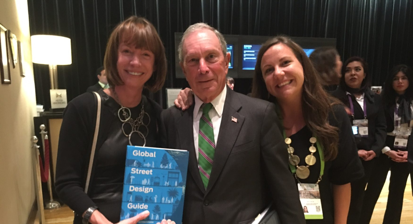 Picture of Janette Sadik-Khan, Mike Bloomberg, and Skye Duncan holding the Global Streets Design Guide